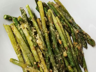 close-up photo of roasted asparagus with parmesan