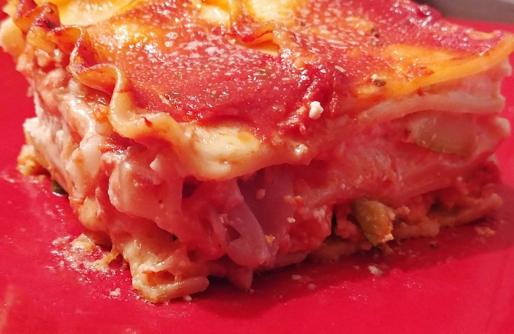 vegetable lasagna on a red plate