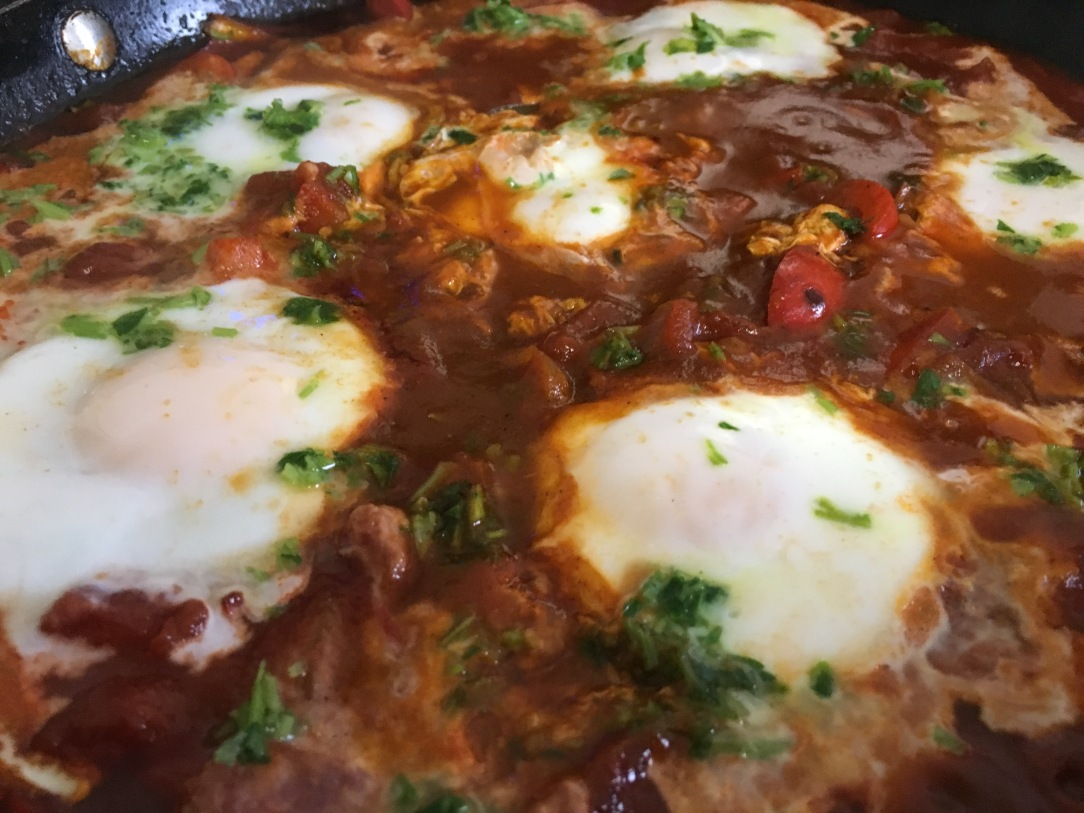 closeup photo of shakshouka in a skillet