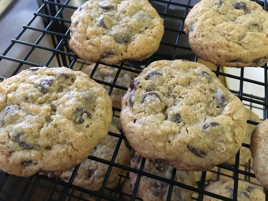 whole wheat chocolate chip cookies on a wire cooling rack